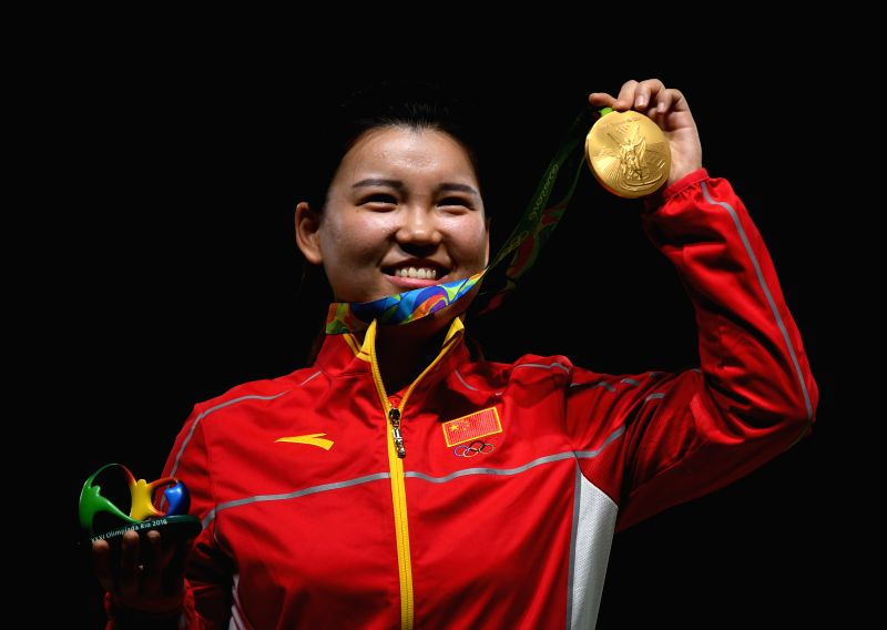 ?Zhang Mengxue of China shows the gold medal at the awarding ceremony of the Women's 10m Air Pistol of the 2016 Rio Olympic Games at the Olympic Shooting ...