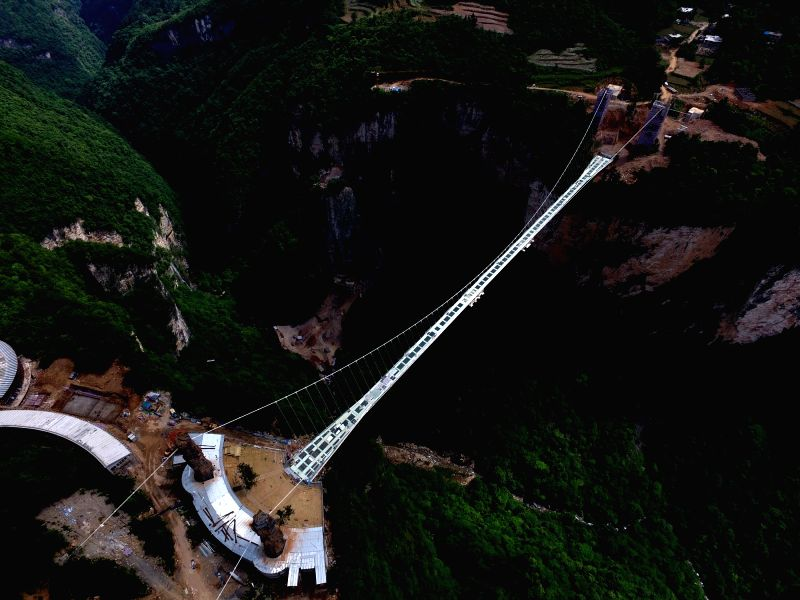 ZHANGJIAJIE, May 17, 2016 - An aerial photo taken on May 17, 2016 shows the nearly finished construction site of a glass bridge at the Grand Canyon of Zhangjiajie National Forest Park, central ...