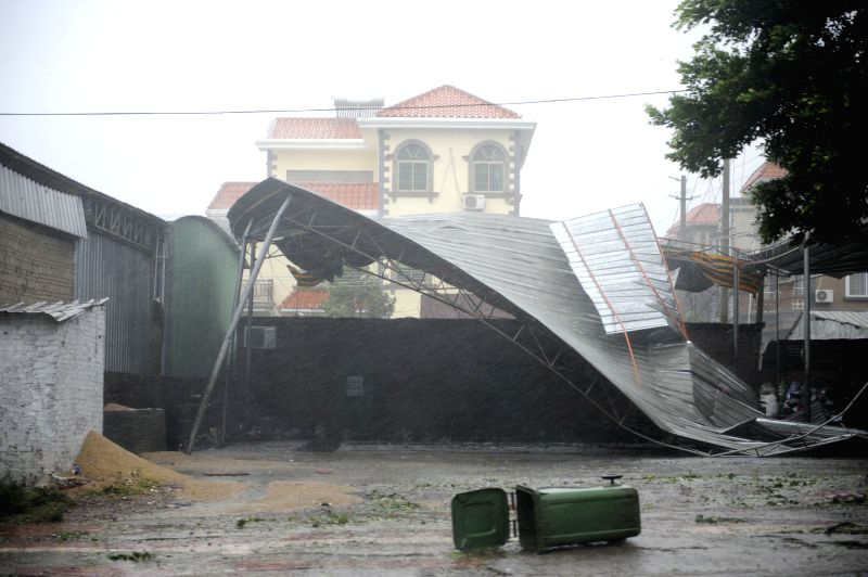A shed is blown down in Zhanjiang City of south China's Guangdong Province, July 18, 2014. Super typhoon Rammasun made its landfall in Zhanjiang at 7:30 p.m. ...