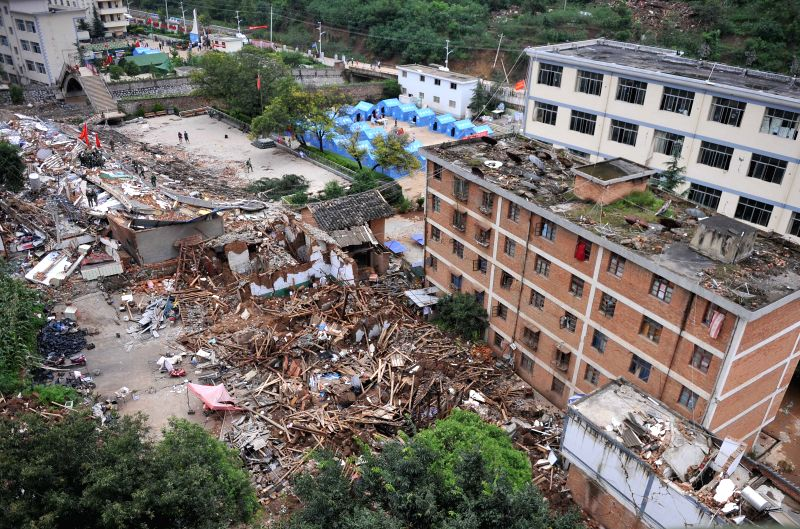 Aerial photo taken on Aug. 4, 2014 shows the quake-hit Longtoushan Town of Ludian County in Zhaotong City, southwest China's Yunnan Province. At least 381 people ...