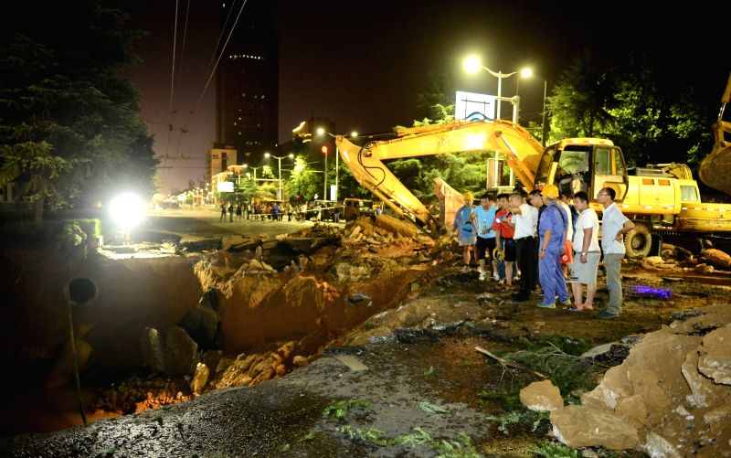ZHENGZHOU, Aug. 2, 2016 - Rescuers work at a cave-in site in Zhengzhou, capital of central China's Henan Province, Aug. 2, 2016. A road collapsed in Zhengzhou on Monday night, causing a couple of ...