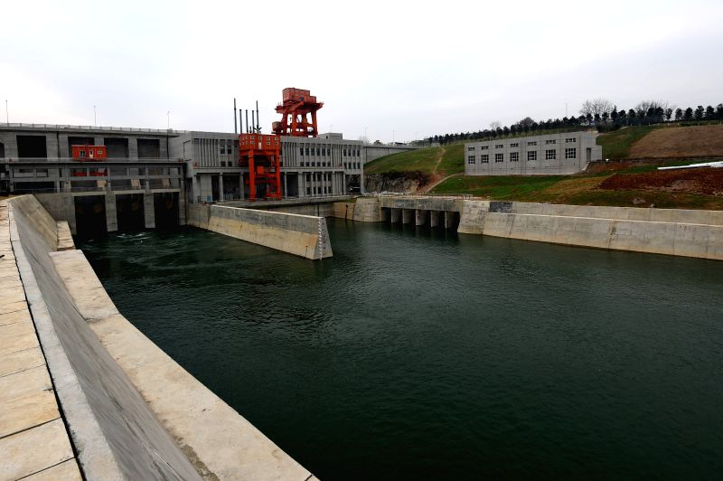 Photo taken on Dec. 3, 2014 shows the sluice of a canal of the south-to-north water diversion project in Xichuan County, central China's Henan Province. The ...