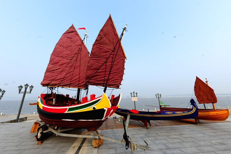 Classical boats are displayed during the 2014 China (Zhoushan Archepelago) International Boat Show in Zhoushan, east China's Zhejiang Province, July 11, 2014. ...