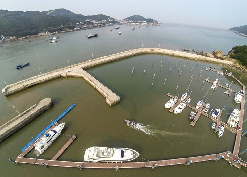 Yachts are harbored for display during the 2014 China (Zhoushan Archepelago) International Boat Show in Zhoushan, east China's Zhejiang Province, July 11, 2014. ...