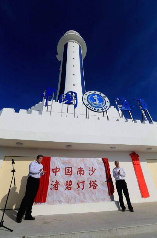 ZHUBI REEF, April 6, 2016 - Guests attend the completion ceremony for the construction of a lighthouse on Zhubi Reef, of Nansha Islands in the South China Sea, south China, April 5, 2016. The ...