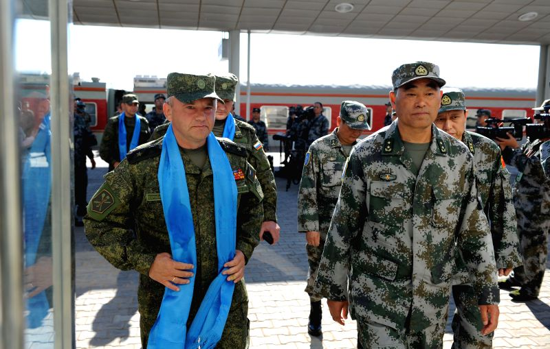 Commanders from Russia and China are seen at the railway station of Zhurihe training base, north China's Inner Mongolia Autonomous Region, Aug. 16, 2014. The first .
