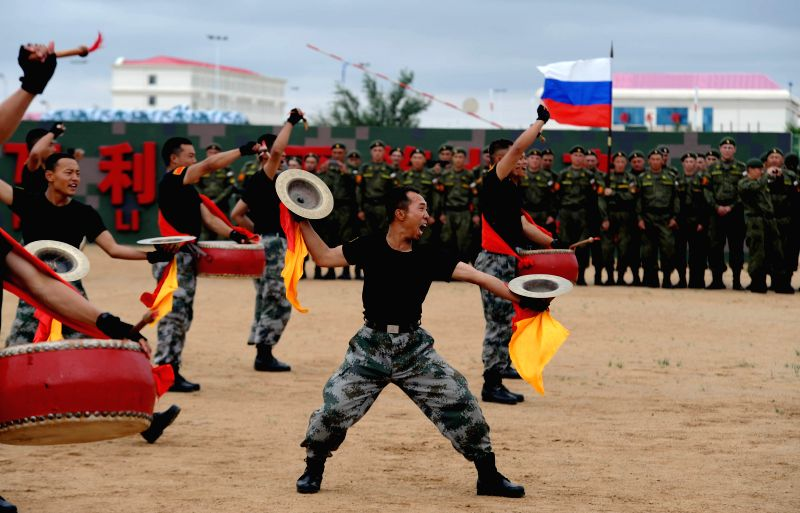 Chinese soldiers perform for foreign participants ahead of the Peace Mission-2014 anti-terror drill at the Zhurihe training base, north China's Inner Mongolia ...