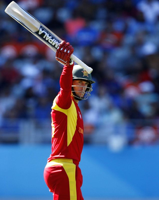 Zimbabwean batsman Sean Williams celebrates his half century during an ICC World Cup 2015 match between India and Zimbabwe at the Eden Park in Auckland, New Zealand on March 14, 2015. - Sean Williams