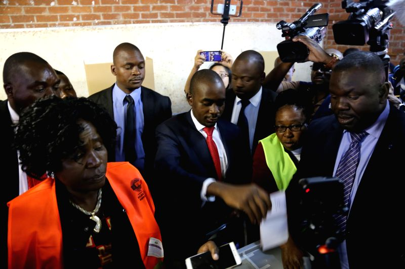 : Zimbabwean opposition MDC Alliance leader Nelson Chamisa (C) votes in Kuwadzana, Harare, Zimbabwe, July 30, 2018. Zimbabweans began voting on Monday in the ...