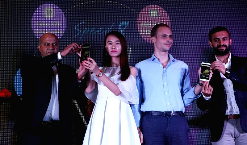 Zopo Mobile Brand Manager Charles Bird and Adcom Founder & Chairman Sanjeev Bhatia during the launch of Zopo mobile's smartphone 'Speed 8' in New Delhi on July 20, 2016.