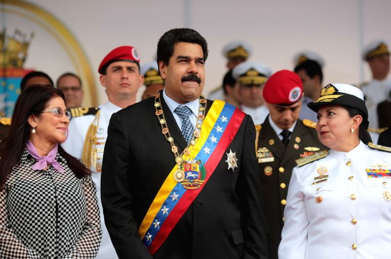 Venezuela's President Nicolas Maduro (C) participate in the parade to commemorate the 191st anniversary of the Naval Battle of Maracaibo Lake and the Army Day in ...