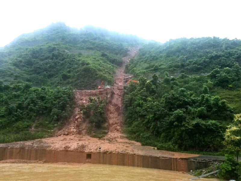 Photo taken by a mobile phone shows the mudslide in Xinzhan Township, Tongzi County, southwest China's Guizhou Province, July 15, 2014. A rain-triggered landslide on .