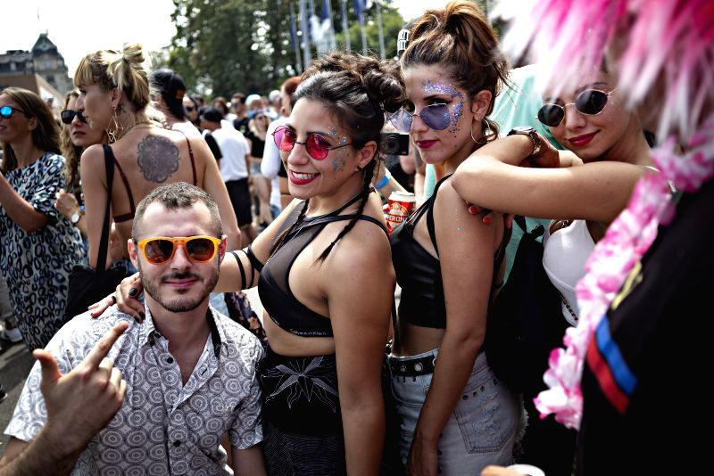 """ZURICH, Aug. 11, 2018 - People participate in the 27th Zurich Street Parade in central Zurich, Switzerland, Aug. 11, 2018. With this year's motto """"Culture of Tolerance"""", the annual dance ..."""