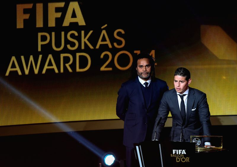 Colombia's midfiedler James Rodriguez (R) speaks after receiving the 2014 FIFA Puskas Award for best goal during the FIFA Ballon d`Or award ceremony at the ...