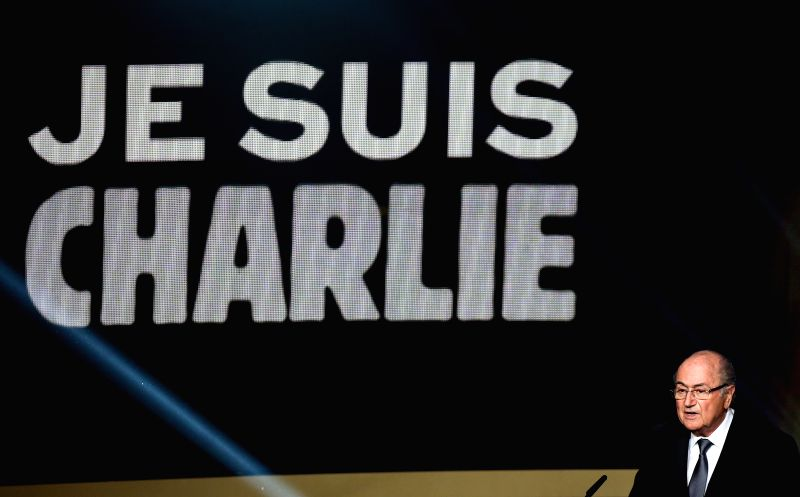 FIFA President Sepp Blatter speaks in tribute to the victims of the terrorist attack on satirical weekly Charlie Hebdo of France during the FIFA Ballon d`Or award ...