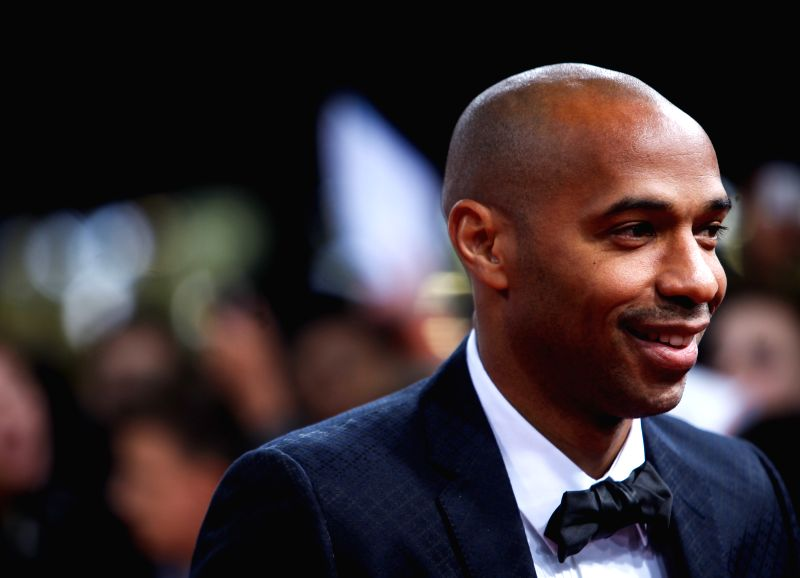 Former French football player Thierry Henry poses on the red carpet ahead of the 2014 FIFA Ballon d`Or award ceremony in Zurich, Switzerland, Jan. 12, 2015. ...