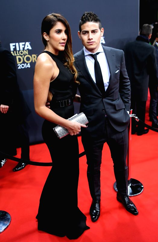 James Rodriguez (R) of Colombia poses with his wife on the red carpet ahead of the 2014 FIFA Ballon d`Or award ceremony in Zurich, Switzerland, Jan. 12, 2015. ...