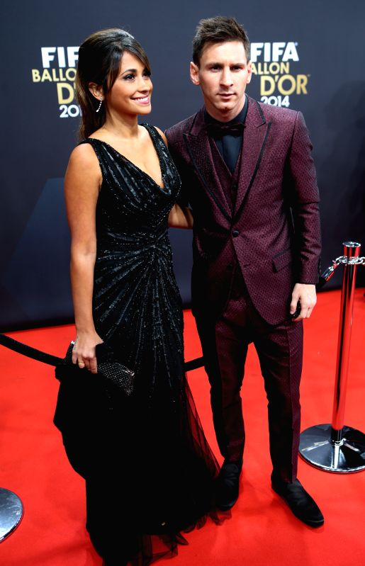 Lionel Messi (R) of Argentina poses with Argentinian model Antonella Roccuzzo on the red carpet ahead of the 2014 FIFA Ballon d`Or award ceremony in Zurich, ... - Antonella Roccuzzo