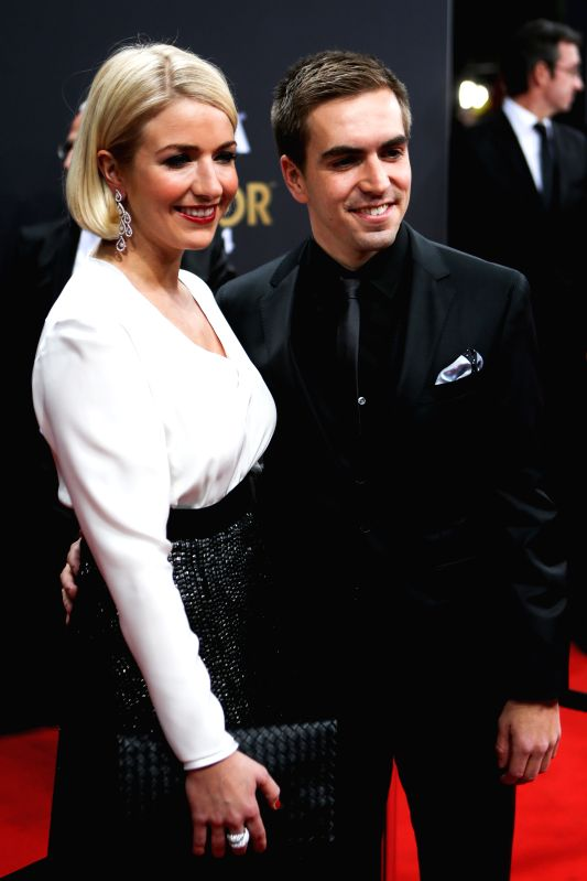 Philipp Lahm (R) of Germany poses with his wife on the red carpet ahead of the 2014 FIFA Ballon d`Or award ceremony in Zurich, Switzerland, Jan. 12, 2015. ...