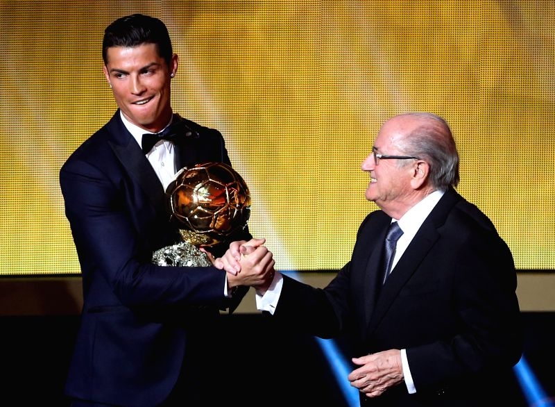 Real Madrid and Portugal forward Cristiano Ronaldo (R) shakes hands with FIFA president Sepp Blatter after being announced as the winner of the 2014 FIFA Ballon d`Or