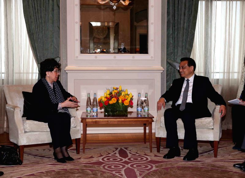 Chinese Premier Li Keqiang (R) meets with the World Health Organization Director General Margaret Chan in Zurich, Switzerland, Jan. 22, 2015. (Xinhua/Liu ...