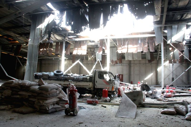A local warehouse is damaged by air strikes on Dec. 3, 2014, in Zuwarah, Libya. The Libyan air force on Wednesday attacked the seaport of Zuwarah city which is controlled by the Islamist ...