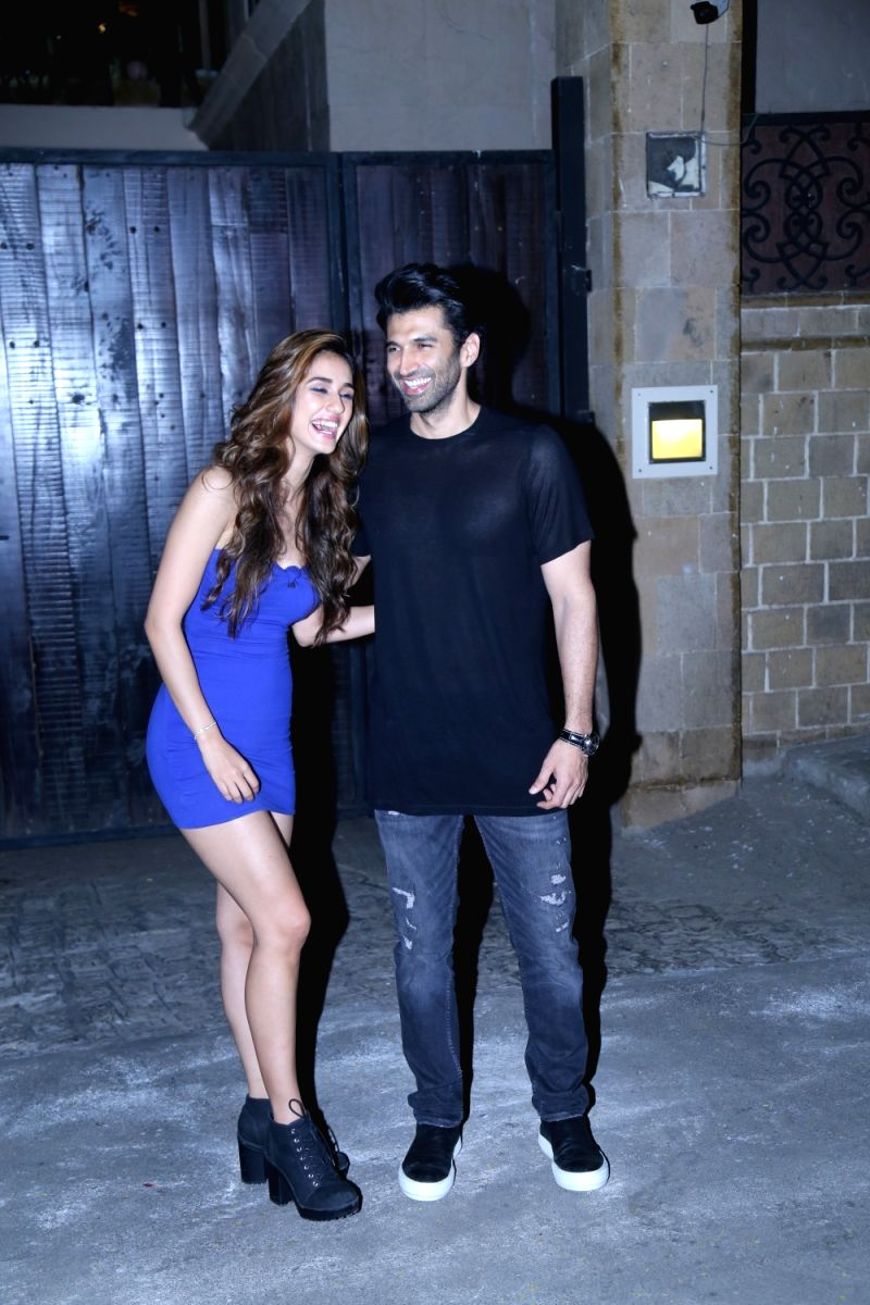 "Actor Disha Patani and Aditya Roy Kapoor at the residence of their co-star from their upcoming film ""Malang"" Anil Kapoor in Mumbai on Dec 19, 2019."