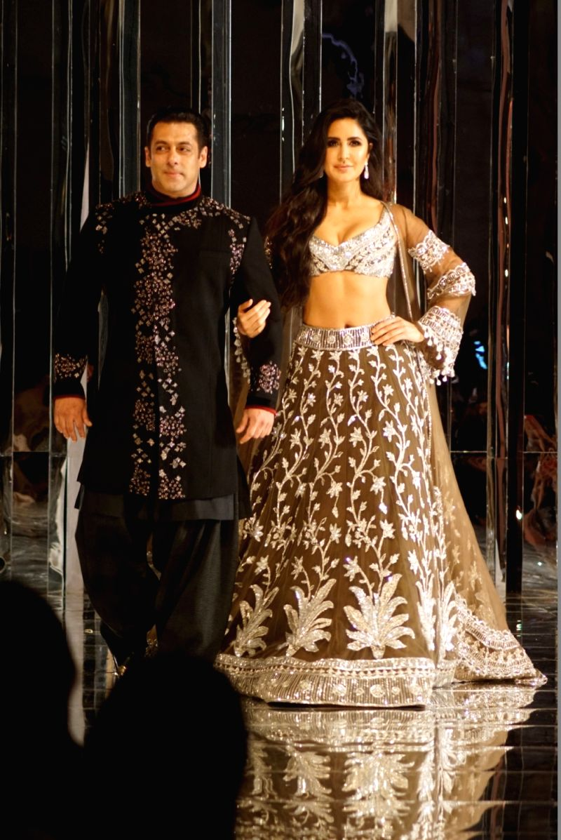 Actors Salman Khan and Katrina Kaif walk on the ramp as show-stoppers for Fashion designer Manish Malhotra's Haute Couture 2018 show at JW Marriot in Mumbai on Aug 1, 2018.