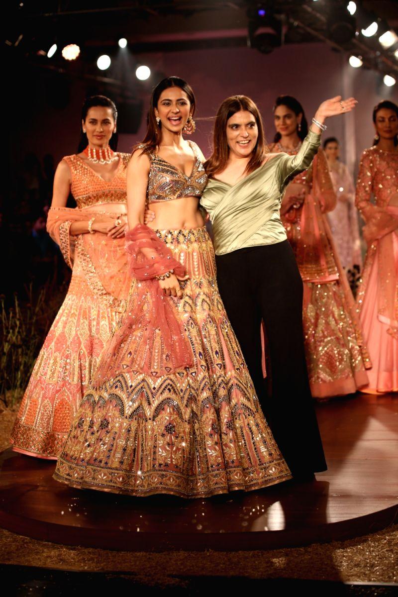 Actress Rakul Preet Singh walks the ramp for designer Reynu Tandon at India Couture Week 2019 in New Delhi, on July 26, 2019.