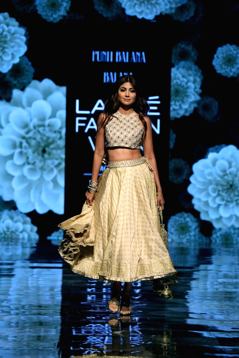 Actress Shilpa Shetty Kundra walks the ramp showcasing fashion designer Punit Balana's creations on Day 5 of the Lakme Fashion Week Winter/Festive 2019 in Mumbai on Aug 25, 2019.