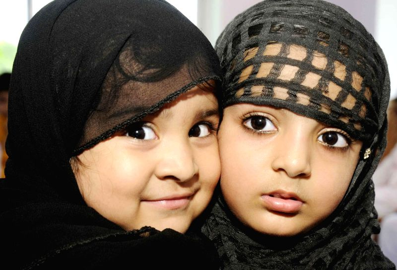 Children celebrate during a Eid Milan programme in Patna on July 26, 2014.