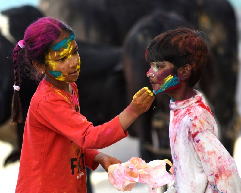Children play with colours on Holi in Bikaner on March 2, 2018.