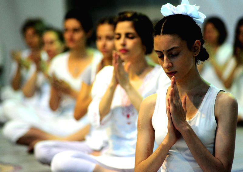 DAMASCUS, June 23, 2017 - Syrian Yoga fans practice yoga during an event marking the International Yoga Day in Damascus, capital of Syria, on June 22, 2017.