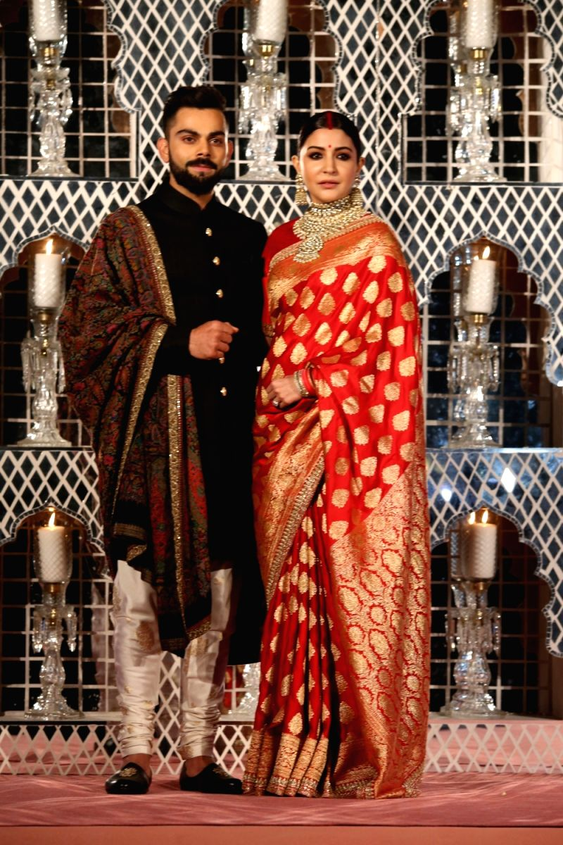 Indian cricket captain Virat Kohli and his wife actress Anushka Sharma during their wedding reception in New Delhi, on Dec 21, 2017.