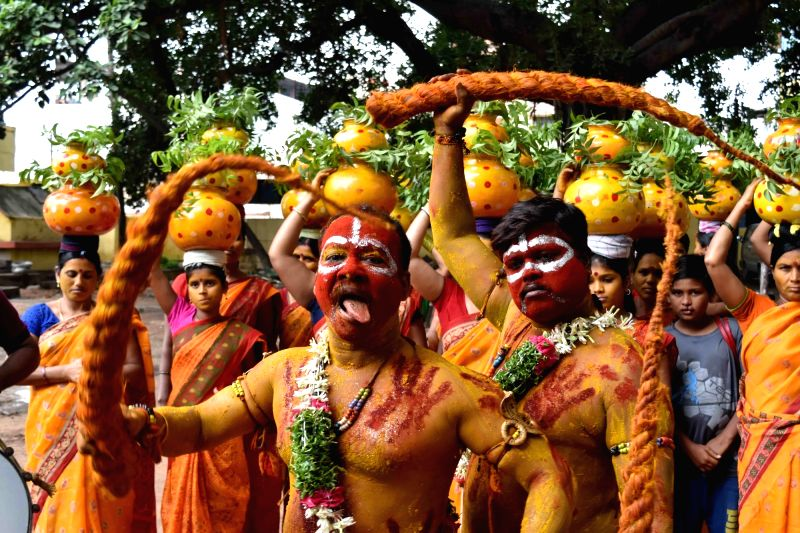 people dress for bonalu procession