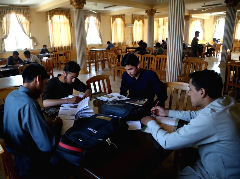 MAZAR-I-Students read books at a library in Mazar-i-Sharif, capital of Balkh Province in north Afghanistan, ahead of the World Book Day, April 21, 2018. April 23 ...