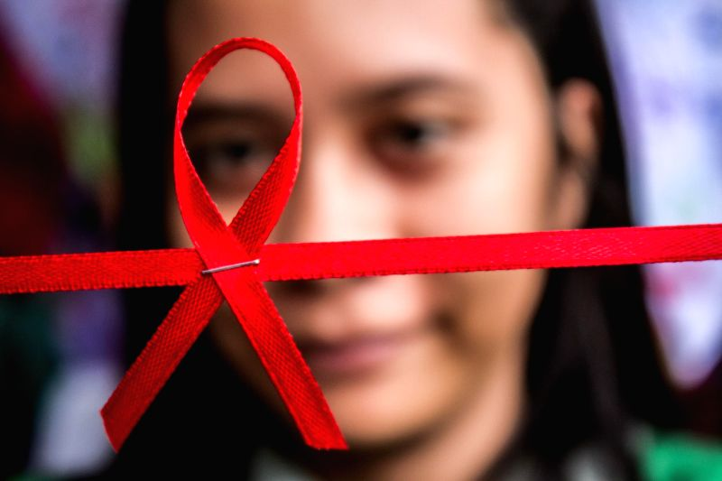 MEDAN(INDONESIA), Dec. 1, 2016 An Indonesian woman holds a red ribbon during commemoration of World AIDS Day in Medan, Indonesia, Dec. 1, 2016.