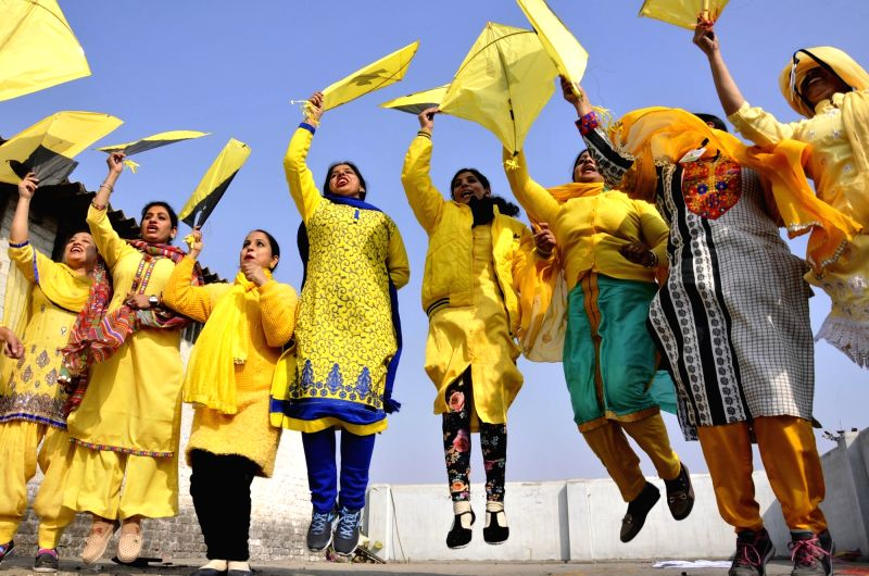 People celebrate Basant Panchami in Amritsar on Jan 22, 2018.
