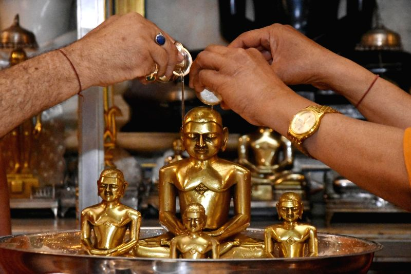 People offer ritual bath - 'abhishek' to the idol of Lord Mahavira on the occasion of Mahavir Jayanti, in Ranchi on March 29, 2018.