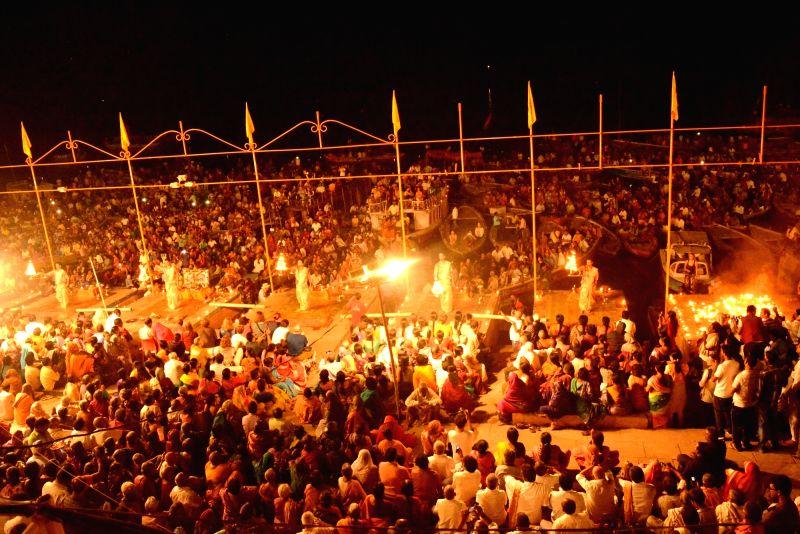 People participate in a Ganga aarti organised for martyrs in Varanasi on Nov 1, 2016.