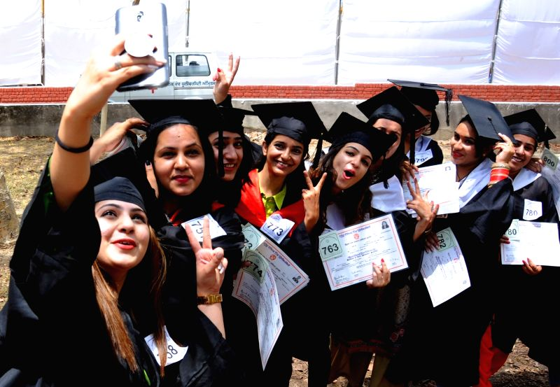 Students jubilant after receiving their degree at the 44th Annual Convocation of Guru Nanak Dev University in Amritsar  on May 31, 2018.