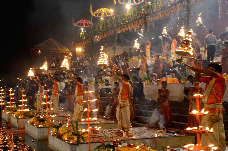 Ganga aarti underway on on the banks of the Ganga river on Dev Deepawali in Varanasi, on Nov 6, 2014.