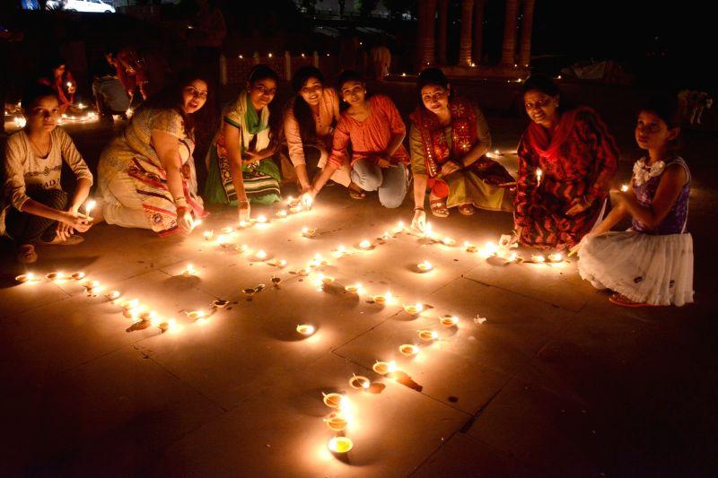 Women celebrate Dev Deepawali in Lucknow on Nov 3, 2017.