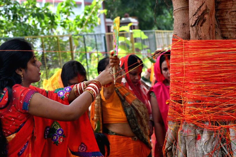 Women perform rituals on the occasion of Vat Savitri Puja, in Patna on May 15, 2018.