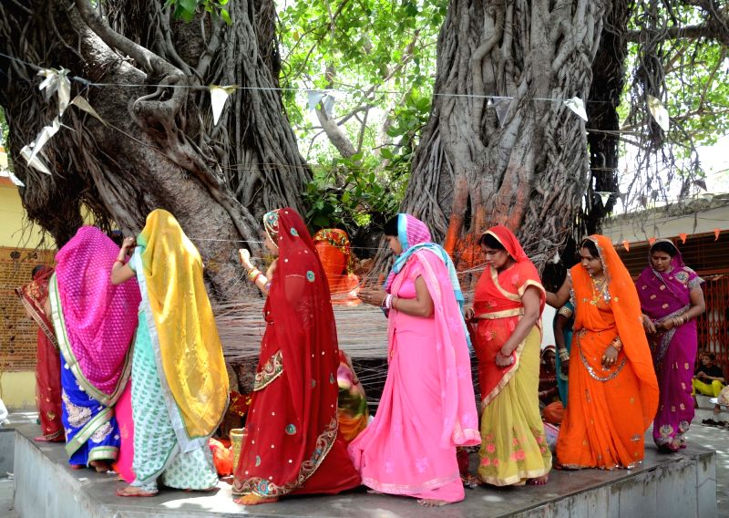 Women perform rituals on the occasion of Vat Savitri Puja, in Bhopal on May 15, 2018.