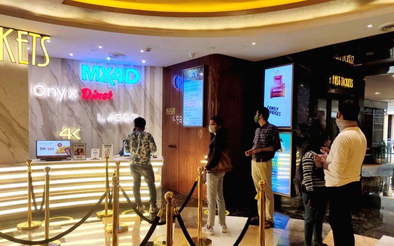 : Mumbai: People outside the movie theatre in Mumbai, on Friday, Oct. 22, 2021. Movie theaters and entertainment capital Mumbai reopened