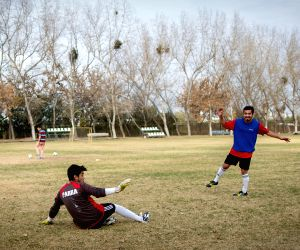 Students play soccer in a field behind the Julio Martinez Pradanos National Stadium, in Santiago, Chile, on June 10, 2015. The National Stadium will be the venue of the opening match of 2015 Chile Copa America between Chile and Ecuador.