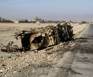 Nangarhar (Afghanistan): A destroyed U.S. military vehicle is seen at the site of suicide car bombing