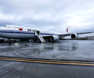 : A Boeing 747-8 Intercontinental airplane to be delivered to Air China is seen in Seattle, the United States, on Sept. 29, 2014. A delivery ceremony for the ...