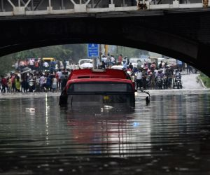 Bus gets partially submerged under Delhi's Minto bridge
